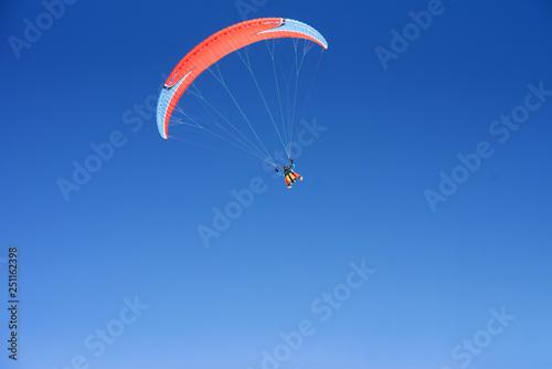 Paragliding, cloudless blue sky © Alla Bacherikova