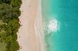 Leinwandbild Motiv Aerial view of sandy beach with tourists swimming in beautiful clear sea water