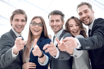 Many happy peoples hands together as team for motivation