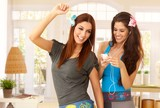 Happy girls dancing and listening to music