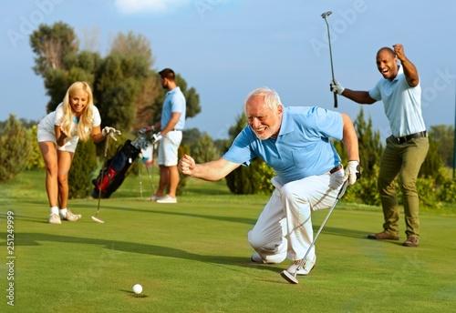 Leinwanddruck Bild Senior golfer putting