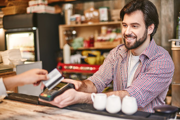 You feel alive to the degree that you feel you can help others. Small business, payment, people and service concept - woman with credit card buying coffee at cafe or coffee shop