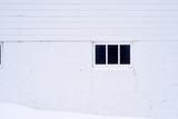 weathered farm building framed window