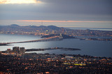 sunset on san francisco bay with panoramic view of the city