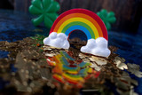 Fototapeta Tęcza - Saint Patrick's Day gold shamrocks reflecting colorful rainbow © Lynne Ann Mitchell