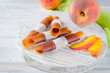 Leinwandbild Motiv Ripe juicy peach and peach candy pastille