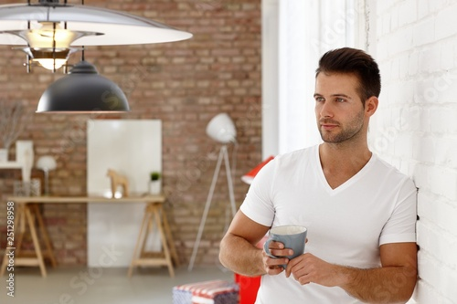 Thoughtful young man with coffee - 251298958