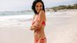 Attractive woman in bikini on the beach