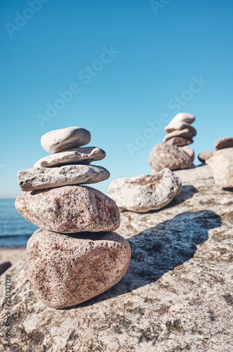 Stack of stones on a beach, balance and harmony concept, selective focus, color toning applied. - 251327129