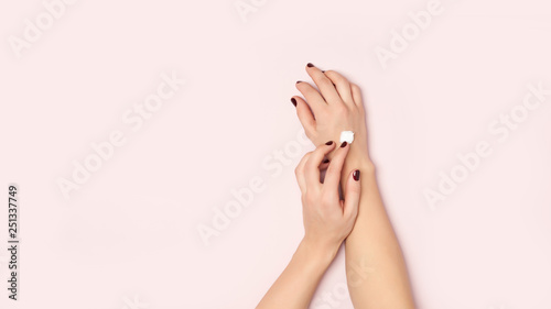 Young woman hands and cream pea