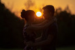 Young couple at sunset, closeup portrait with selective focus