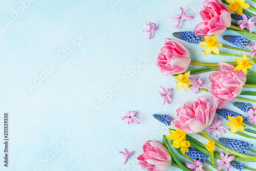 Colorful beautiful spring flowers on pastel table top view. Greeting card for International Women Day. Flat lay. - 251339330