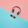 Minimal. Headphones and trendy fashion sunglasses. Music vibration. Hipster DJ accessories set. Art summer vibes style. Coral Blue pastel colored. Creative fashionable flat lay