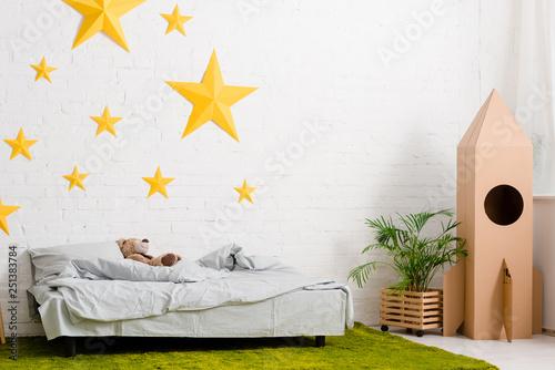 Teddy bear lying on bed in cozy bedroom