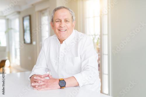 Leinwanddruck Bild Handsome senior man smiling confident