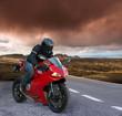 red Biker on a volcanic landscape
