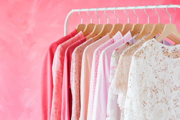 Pink women clothes hanging on rack © Kaspars Grinvalds
