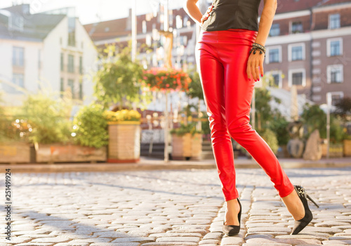 Woman in red leather trousers