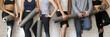 Leinwanddruck Bild - Group people wearing activewear holding yoga mats standing near wall