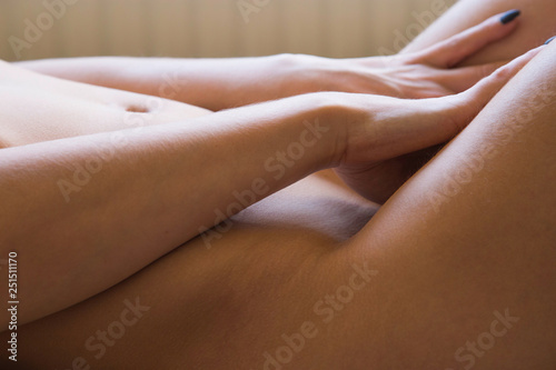 Sexy nude girl lying on bed, body detail, anonymous, blurred background - 251511170