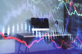 Double exposure of stock market chart and office desktop on background. financial strategy concept. 3d render - 251533166