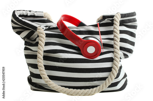 striped beach bag with red headphones - 251547959