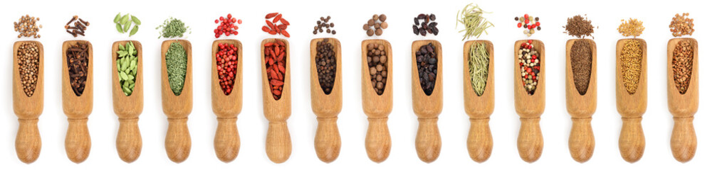 mix of spices in wooden scoop isolated on a white background. Top view. Flat lay. Set or collection © kolesnikovserg