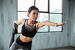stretching sport woman in sport wear indoor exercising. healthy fitness female