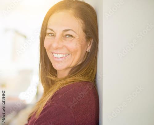 Leinwandbild Motiv Beautiful middle age woman smiling at home