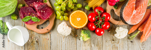 Flexitarian diet diet, with fresh vegetables, raw meat and fish, legumes, grains, fruit, wooden background, copy space top view