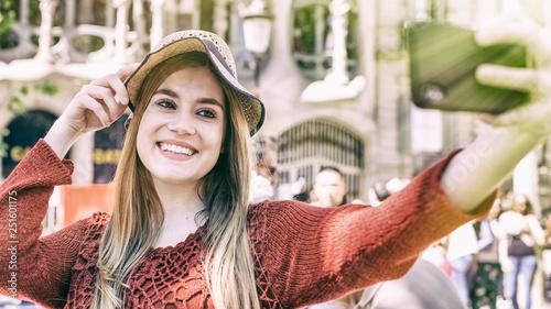 obraz lub plakat Happy girl making selfie outdoor