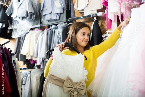 Little girl deciding on pretty dress