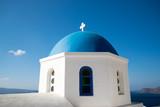 Greek blue dome white building cross
