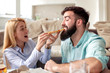 Couple eating pizza at home,enjoying together
