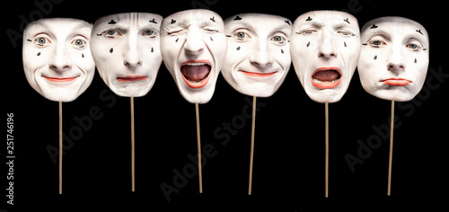 Masks with different emotions of pantomime on the black background