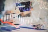 Hands typing on laptop. Business and Financial concept. Double exposure of stock market charts. - 251768135