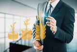 Double exposure with growth coins columns and man hand. Concept of success savings and capital. - 251768327