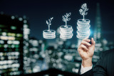 Double exposure with growth coins columns and man hand. Concept of success savings and capital. - 251768367