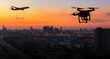 Leinwanddruck Bild - Silhouette of drone flying near an airport with airplane, no drone zone concept