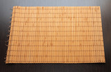 bamboo napkin on a dark wooden background isolated
