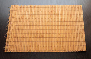 bamboo napkin on a dark wooden background isolated © Наталья Вавилина