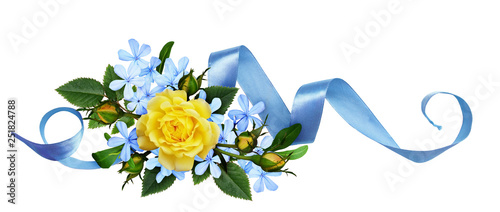 Yellow roses and blue small flowers with silk ribbon in a floral arrangement