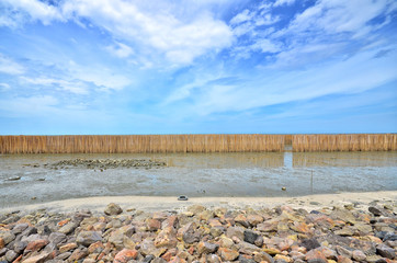 Barrier bamboo protech sea wave at the coast © 25krunya