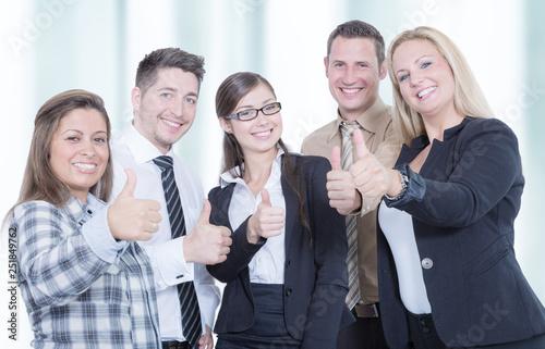 Leinwandbild Motiv business team shows thumb up