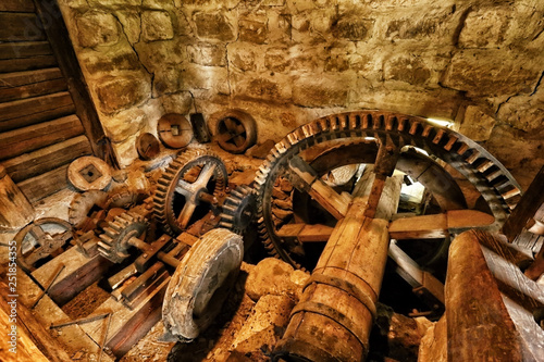 Plenty of wooden cog-wheels in the old mill - 251854355