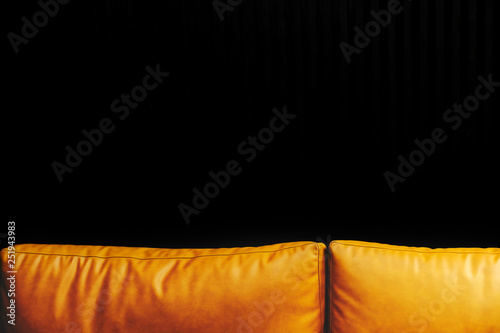 Mustard leather cushions and black background - 251943983