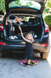 Boy and girl playing in the car
