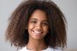 Leinwanddruck Bild - Attractive black teenager girl smiling looking at camera