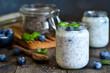 Leinwandbild Motiv Homemade yogurt with sesena chia and blueberries that have a dark background. Proper nutrition.