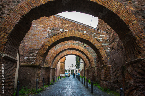 Ancient street with arches in the center of Rome - 251989328